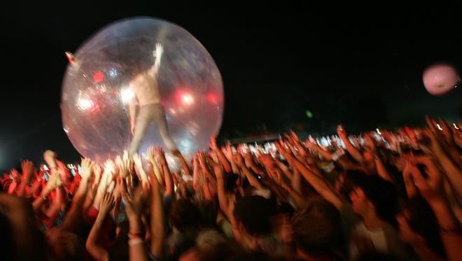 Lead singer Wayne Coyne crowd surfs during the Flaming Lips show at Bonnaroo 2007 in Manchester, Tenn.