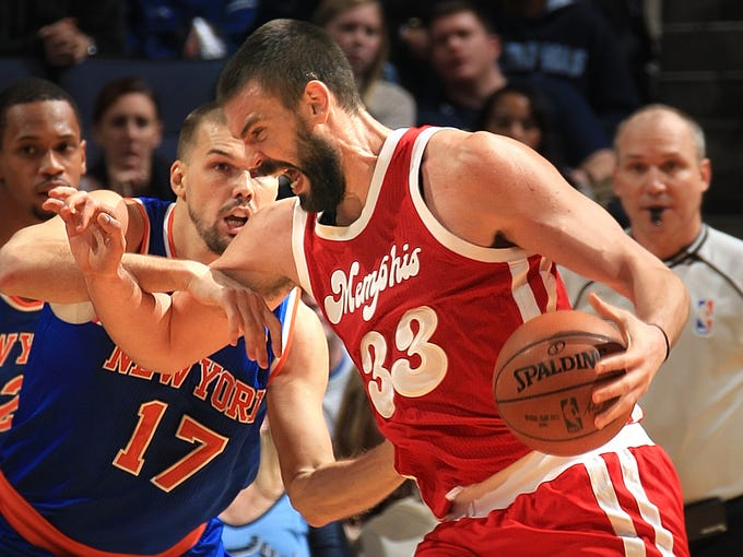January 16, 2016 -  Memphis Grizzlies Marc Gasol, right, makes an aggressive move to the basket defended by New York Knicks Lou Amundson at FedExForum.