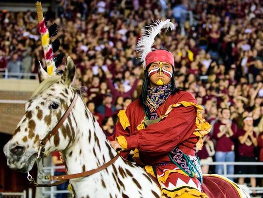 Chief Osceola and Renegade introduce home football