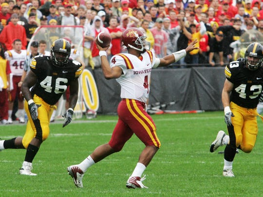 Iowa State quarterback Austen Arnaud is pursued by Iowa's Christian Ballard (46) and Pat Angerer (43) during the first quarter of their game Saturday, Sept. 13, 2008.
