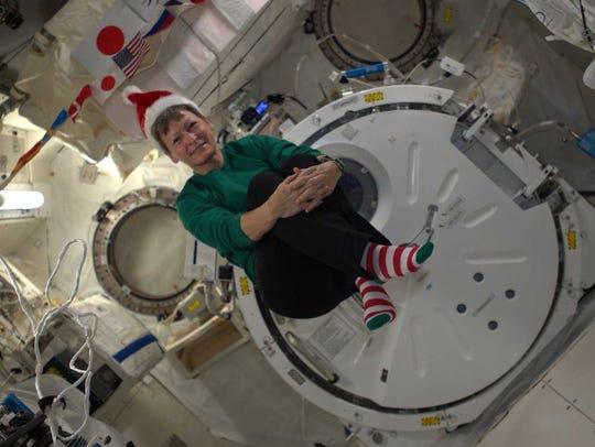 Astronaut Peggy Whitson celebrates Christmas aboard