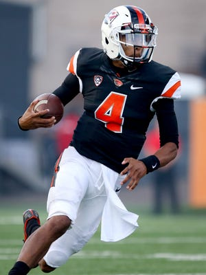 Oregon State quarterback Seth Collins (4) scrambles against Weber State during the first half at Reser Stadium, Friday, September 4, 2015, in Corvallis. The Beavers won the game 26-7.
