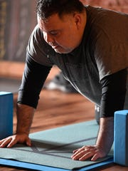 Bart Moore works up a sweat during a Yoga Alternative therapy class Saturday morning, March 25, 2017.