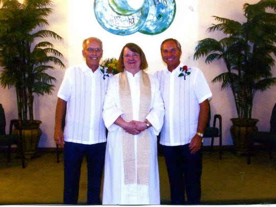 Jim Madura and Gordon Dunn with Rev. Margaret L. Beard after their wedding ceremony.