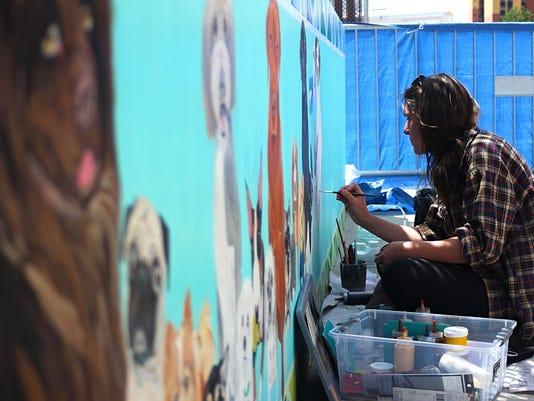 Tahoe artist Hannah Eberle paints pet mural downtown Reno