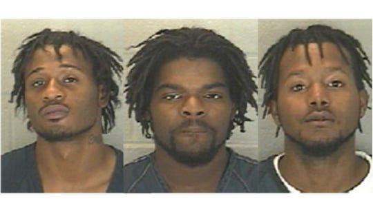 Andre Brown, Charles Jenkins Jr. and Tyler Chandler, were arrested Sunday on robbery while armed with a firearm, a Level 3 felony.