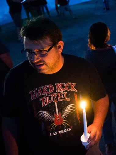 John Gilchrist, left, and Danny Thornton, talk with those around them before the candlelight vigil for Mike and Tina Careccia at Pacana Park in Maricopa on Friday, July 3, 2015.