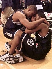 Butler's Mike Marshall left comforts teammate LaVall