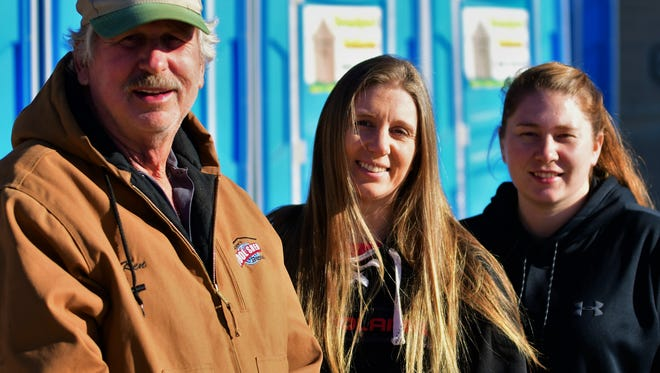 "Ken Chapman, along with daughters Heather (center) and Phylicia run the Eastland-based ""Grandpaw's Outhouse"" - one of three successful businesses the family operates from the same site."