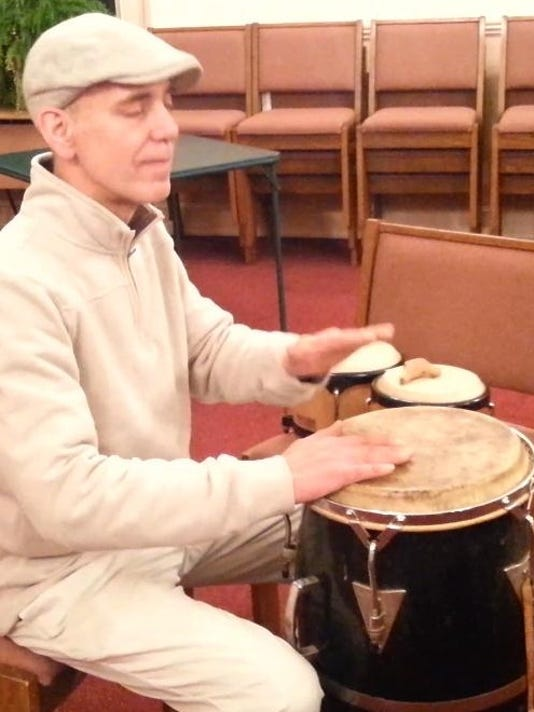 John Graziano of Plaintfield leads drum circle.jpg