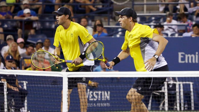Bob Bryan, left, and Mike Bryan eased past Eric Butorac of the USA and Frederik Nielsen of Denmark in the second round on Friday.