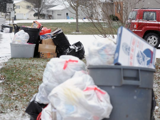 Garbage is piling up in several neighborhoods in Licking, Perry and Fairfield counties where customers have CMI Waste Removal services. Customers say despite prepaying, in some cases a year in advance, for trash service the company frequently neglects to pick trash up for weeks at a time.