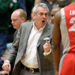 New Mexico coach Craig Neal reacts towards guard Sam Logwood (20) in the first half of a game against Colorado State.