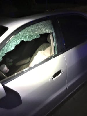 A shooting on Spruce Street injured two men and caused damage to this vehicle. Police are asking for the public's assistance in the investigation.