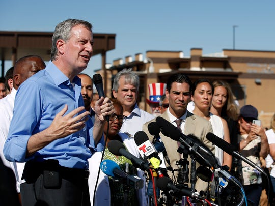 In this Thursday, June 21, 2018, file photo, New York Mayor Bill de Blasio speaks alongside a group of other U.S. mayors during a news conference outside a holding facility for immigrant children in Tornillo, Texas, near the Mexico border. U.S. Customs and Border Protection is alleging that de Blasio illegally crossed from Mexico into the U.S. while visiting the El Paso, Texas, area in June, an accusation the mayor's office flatly denies. (AP Photo/Andres Leighton, File)