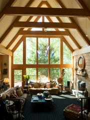 Windows and beams add drama to the sunken living room.