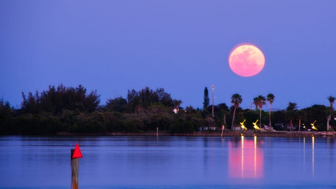 A huge full moon rises the Indian River in this 2011 reader's snapshot by Barbara Oliver.