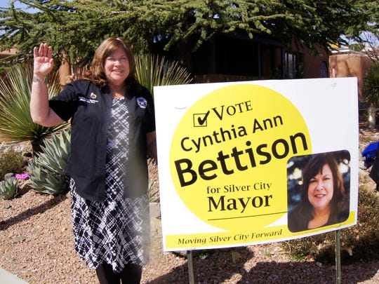 Silver City Town Councilor Cynthia Ann Bettison, a candidate for mayor, waves at traffic on Tuesday in Silver City.