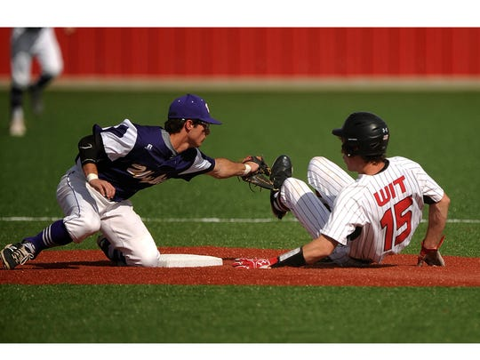 Wylie second baseman Gatlin Martin (21) attempts to tag out Levelland's Nick Gerber (15) trying to steal second base during the bottom of the first inning of the Bulldogs' 3-1 win in the Region I-4A semifinal playoff on Thursday, May 25, 2017, at Cardinal Field in Hermleigh.