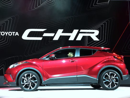 The new Toyota C-HR is driven on stage during its introduction