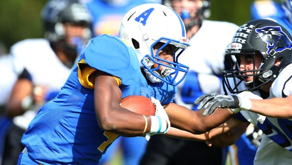 Ardsley's Jalen Leonard-Osbourne (4) gets yards during