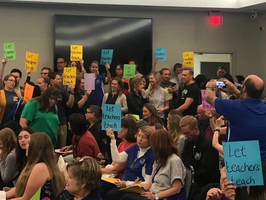 Teachers and students held signs at Tuesday's board
