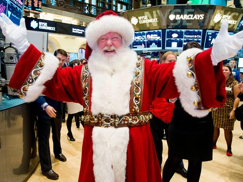 A man portraying Santa Claus visits the trading floor of the New York Stock Exchange, Wednesday Nov. 21, 2012 before he participated in opening bell ceremonies featuring the Macy's Thanksgiving Day Parade.