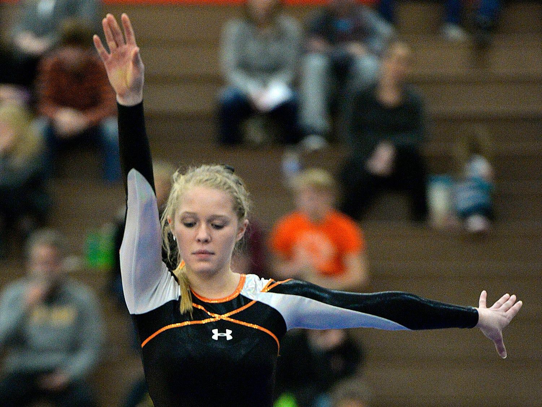 St. Cloud Tech senior gymnast Kalley Thompson performs Saturday, Dec. 5 on the balance beam during the St. Cloud Apollo Gymnastics Invite.