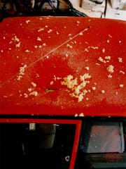 The roof of this red car was struck by a meteorite Sept. 1, 1997 in northeast Washtenaw County.