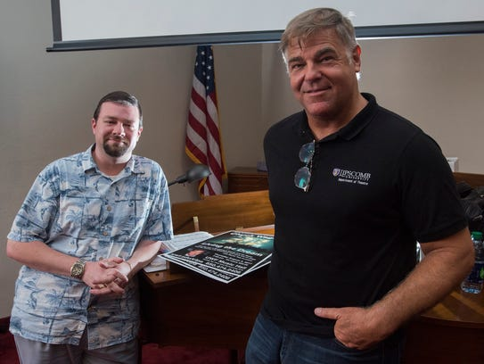 Pensacola resident Chuck Wagner, right, and accompanist