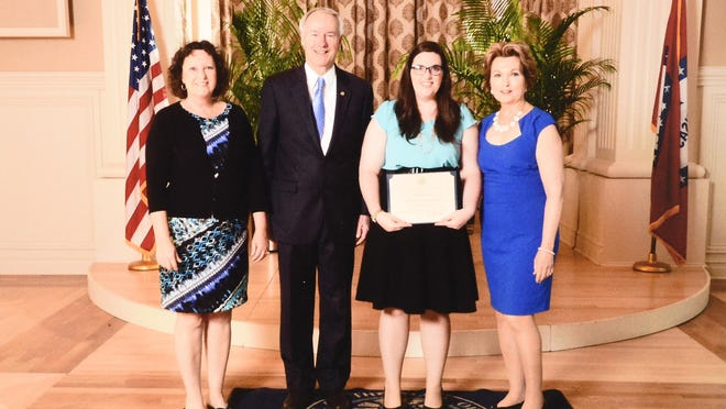 Madeline Malloy, third from left, recently was honored at the Scholastic Honors Day at the Governor's Mansion in Little Rock. Also shown are from left, her mother, Denise Malloy, Gov. Asa Hutchinson and first lady Susan Hutchinson.