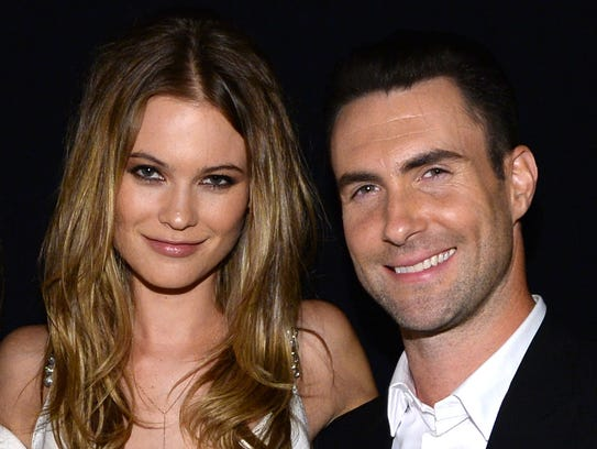 "FILE - JULY 19: Singer Adam Levine and Behati Prinsloo are reportedly getting married in Cabo San Lucas, Mexico on July 19, 2014. LOS ANGELES, CA - JANUARY 27:  (L-R) Model Behati Prinsloo and recording artist Adam Levine of Maroon 5 attend ""The Night That Changed America: A GRAMMY Salute To The Beatles"" at the Los Angeles Convention Center on January 27, 2014 in Los Angeles, California.  (Photo by Larry Busacca/Getty Images for NARAS)"