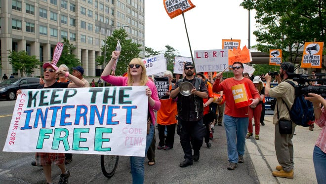 "Protesters hold a rally to support ""net neutrality"" outside the Federal Communications Commission on May 15, 2014."