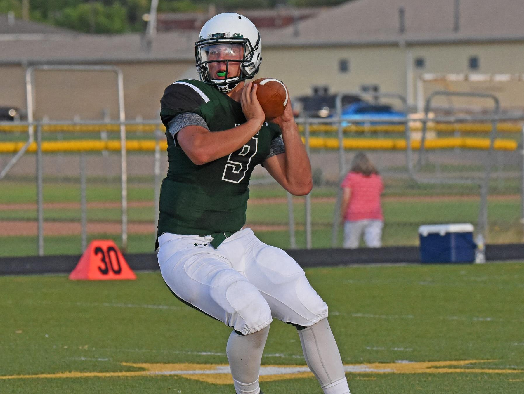Fossil Ridge football quarterback Griffin Roberts looks for an open receiver in a scrimmage against Mountain View.