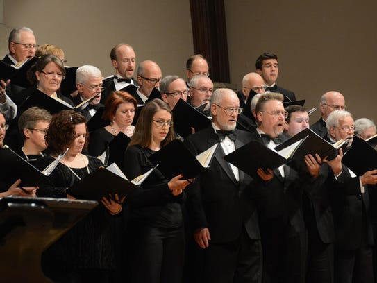 The Cappella Festiva choir is shown during a performance.