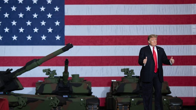 US President Donald Trump arrives to speak after touring the Lima Army Tank Plant at Joint Systems Manufacturing in Lima, Ohio, March 20, 2019. (Saul Loeb/AFP/Getty Images/TNS)