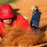 Petal's Peyton Swilley slides back to first base Friday during the Panthers' 6A playoff game against Harrison Central.