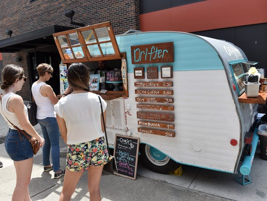 Customers line up at Drifter Coffee outside Shed 5