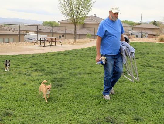 Randy Brown's two dogs, Peaches and Chewy, follow him