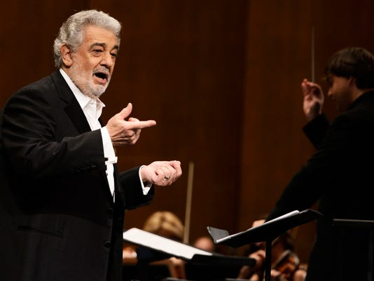 FILE - In this June 7, 2013 file photo, tenor Placido Domingo performs at the Dorothy Chandler Pavilion in Los Angeles. Domingo will sing before a World Cup final for the sixth time, announcing Wednesday, June 11, 2014 he will perform at Rio de Janeiro's HSBC Arena on July 11. (Photo by Dan Steinberg/Invision/AP, File)