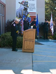 Village of Howard fire Chief Don Phillips bows his