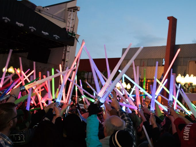 Lightsabers are raised high as the battle draws to