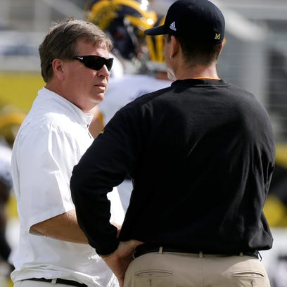 Florida football coach Jim McElwain, left, and Michigan