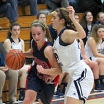 Emma Gerrety of Central Catholic tries to cut off a drive by Kelsey Swisher of Seeger in the second quarter.