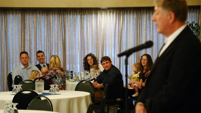 Family members look on during Tom Brennan's speech Thursday evening at his reception.