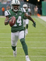 FILE  - In this Sunday, Oct. 15, 2017 file photo, New York Jets wide receiver Jeremy Kerley (14) runs for a touchdown during the first half of an NFL football game against the New England Patriots in East Rutherford, N.J. New York Jets wide receiver Jeremy Kerley is facing a possible suspension. He is uncertain whether he'll be available to play Thursday night, Nov. 2, 2017 against the Buffalo Bills. Kerley would not confirm or deny reports that he will be suspended by the NFL for a violation of league rules.(AP Photo/Seth Wenig, File)