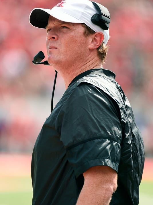 Houston head coach Major Applewhite watches from the sidelines during the first half of an NCAA college football game against Texas Tech, Saturday, Sept. 23, 2017, in Houston. (AP Photo/Eric Christian Smith)