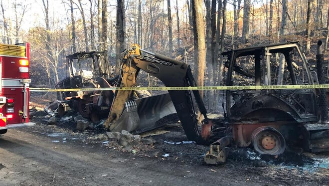 A fire in Blue Mountain Reservation burned as much as 10 acres of parkland and two pieces of construction equipment.