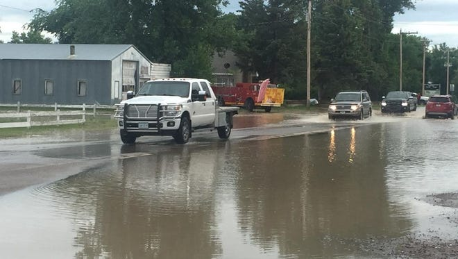 The rising Sun River reached Highway 200 at the town of Sun River just before 7 p.m. Tuesday.