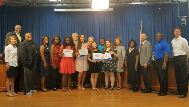 Comcast Leaders and Achievers scholarships recipients in Leon County along with local education leaders, including the superintendent and school board members.